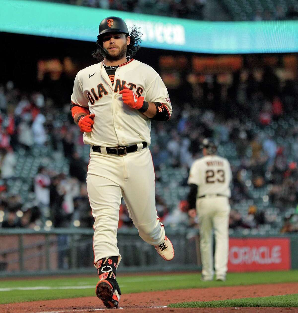 Brandon Crawford (35) touches home after hitting his two-run homerun in the fifth inning as the San Francisco Giants played the Arizona Diamondbacks at Oracle Park in San Francisco, Calif., on Monday, June 14, 2021.