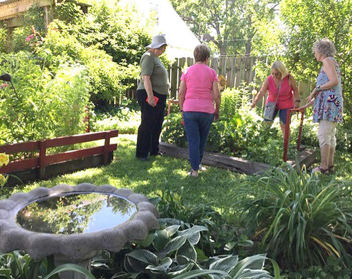 Participants in Sunday's garden walk sponsored by Hope Circle of Centenary United Methodist Church visited five gardens, including Ann Marie Stahel's in Jacksonville.