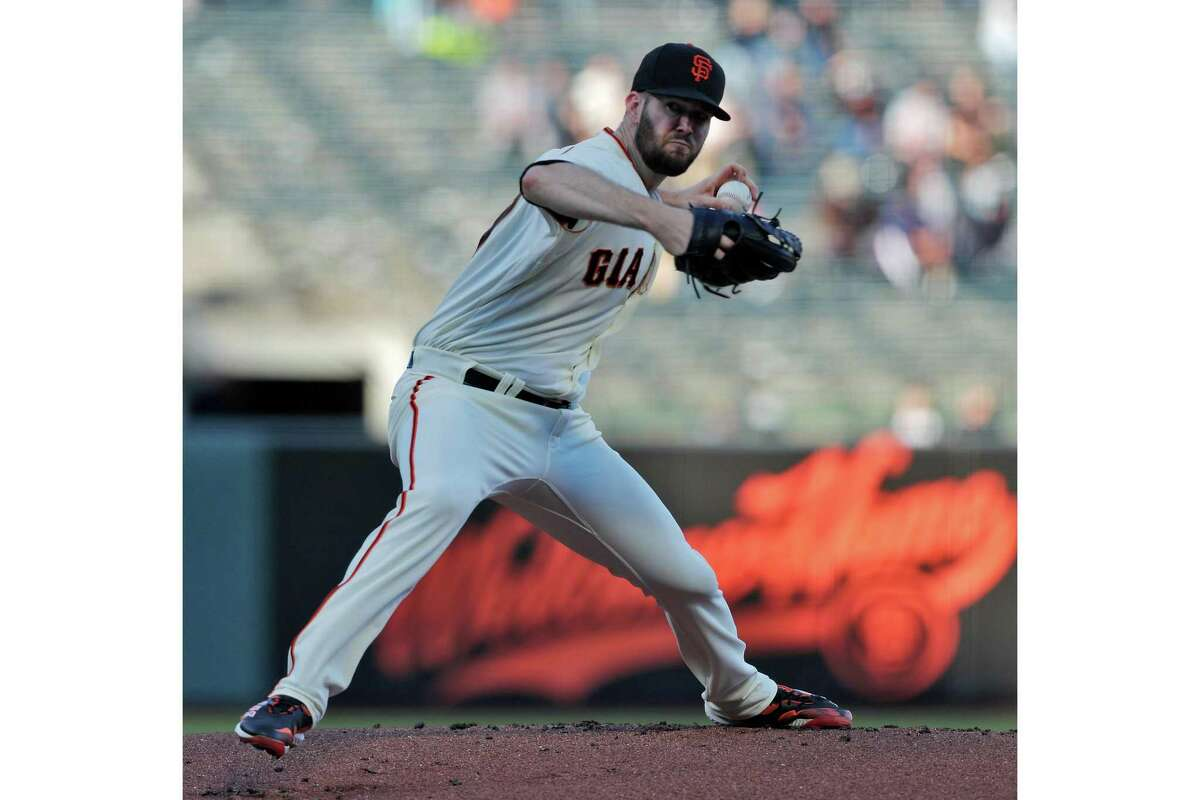 Alex Wood (57) pitches for the Giants in the first inning as the San Francisco Giants played the Arizona Diamondbacks at Oracle Park in San Francisco, Calif., on Monday, June 14, 2021.