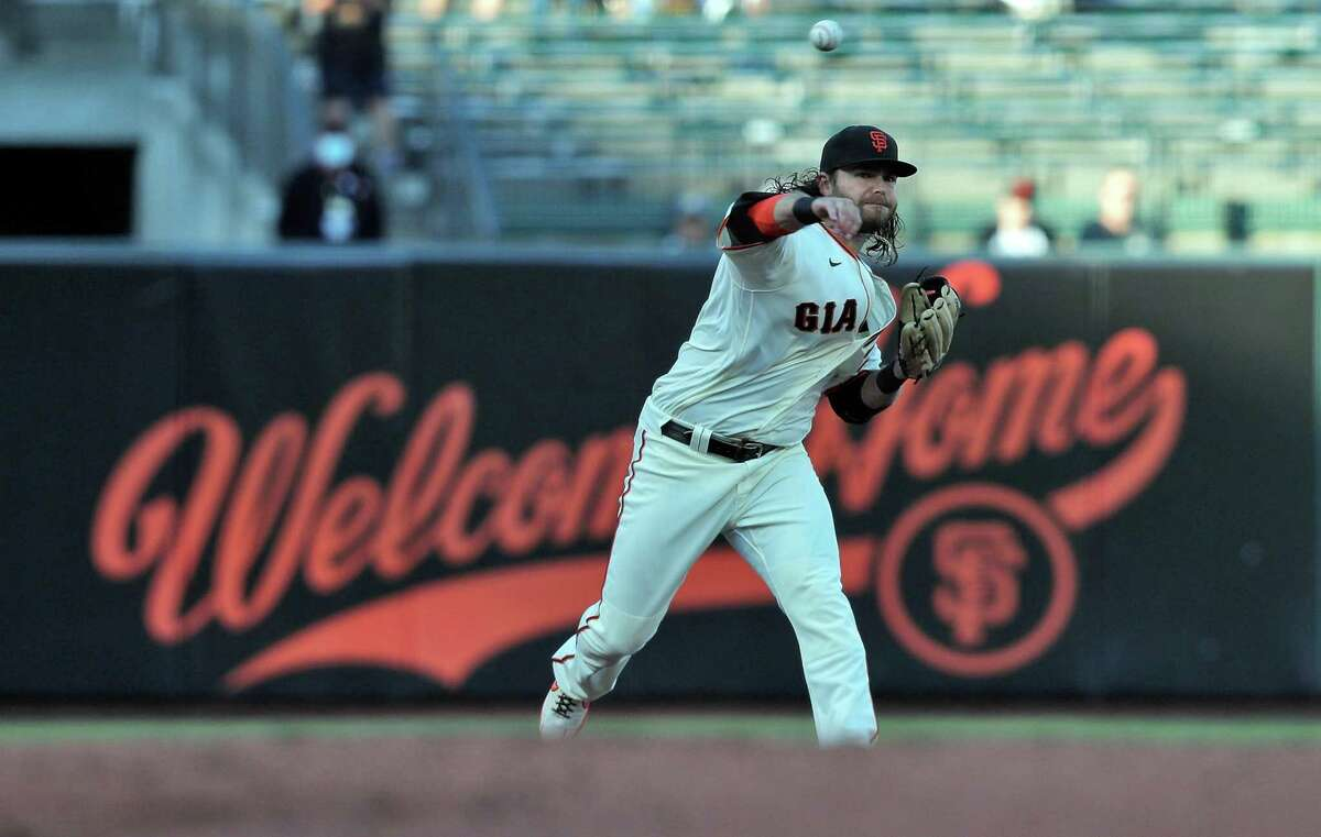 Brandon Crawford (35) throws to first in the first inning as the San Francisco Giants played the Arizona Diamondbacks at Oracle Park in San Francisco, Calif., on Monday, June 14, 2021.