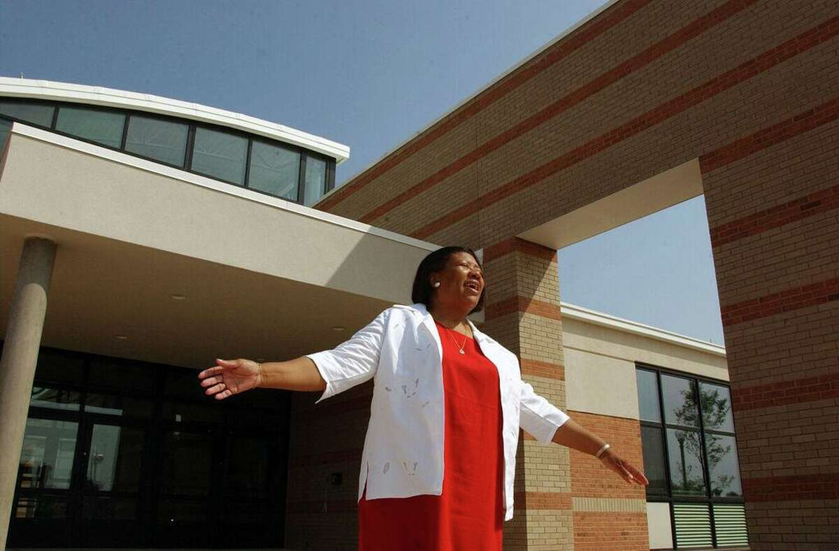 Jeffie Frazier, the the principal of Wexler-Grant Community School, gestures to her friends in the parking lot of the newly renovated school on Foote Street in New Haven in 2002.