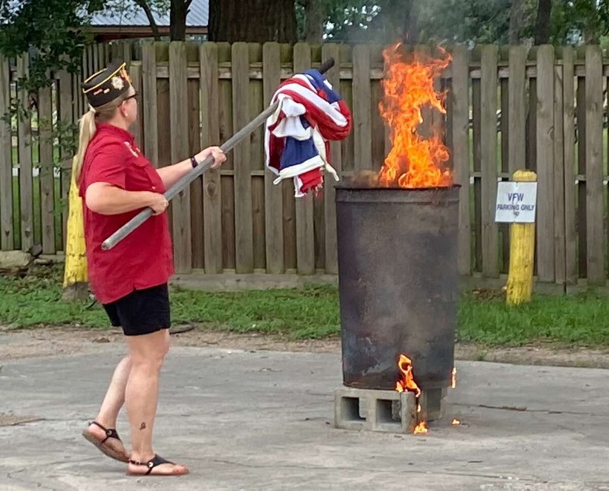 Conroe's VFW Post 4709 commemorated three historic events in American history in one moving ceremony Monday evening. The Post held a ceremony to recognize Flag Day, the anniversary of D-Day and the birthday of the U.S. Army. Pictured here, Post Commander Kelly Glass lowers a flag into the fire.