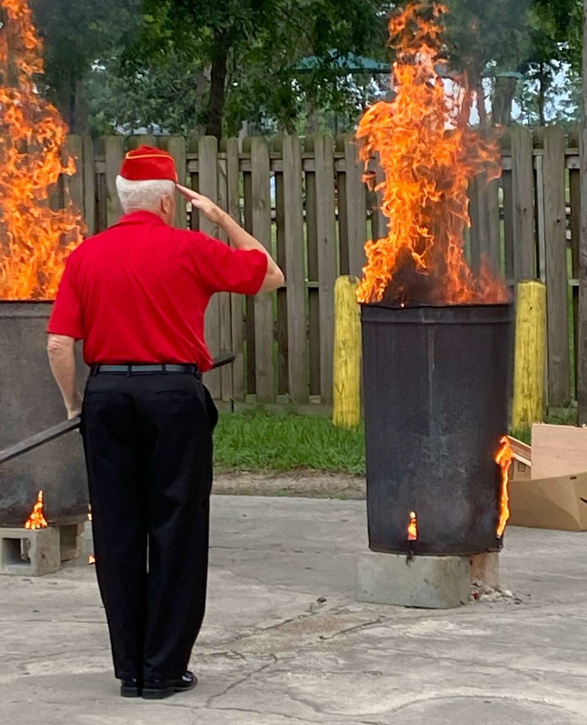 Conroe's VFW Post 4709 commemorated three historic events in American history in one moving ceremony Monday evening. The Post held a ceremony to recognize Flag Day, the anniversary of D-Day and the birthday of the U.S. Army. A member of the Marine Corps League Eastex Detachment salutes the flag he just lowered into the fire.