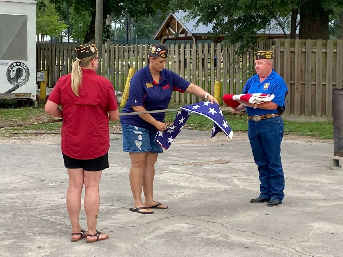 Conroe's VFW Post 4709 commemorated three historic events in American history in one moving ceremony Monday evening. The Post held a ceremony to recognize Flag Day, the anniversary of D-Day and the birthday of the U.S. Army. From left Post Commander Kelly Glass, Junior Vice Commander Marcey Phillips and Post Adjutant Jay Hargrove prepare a flag for retirement.