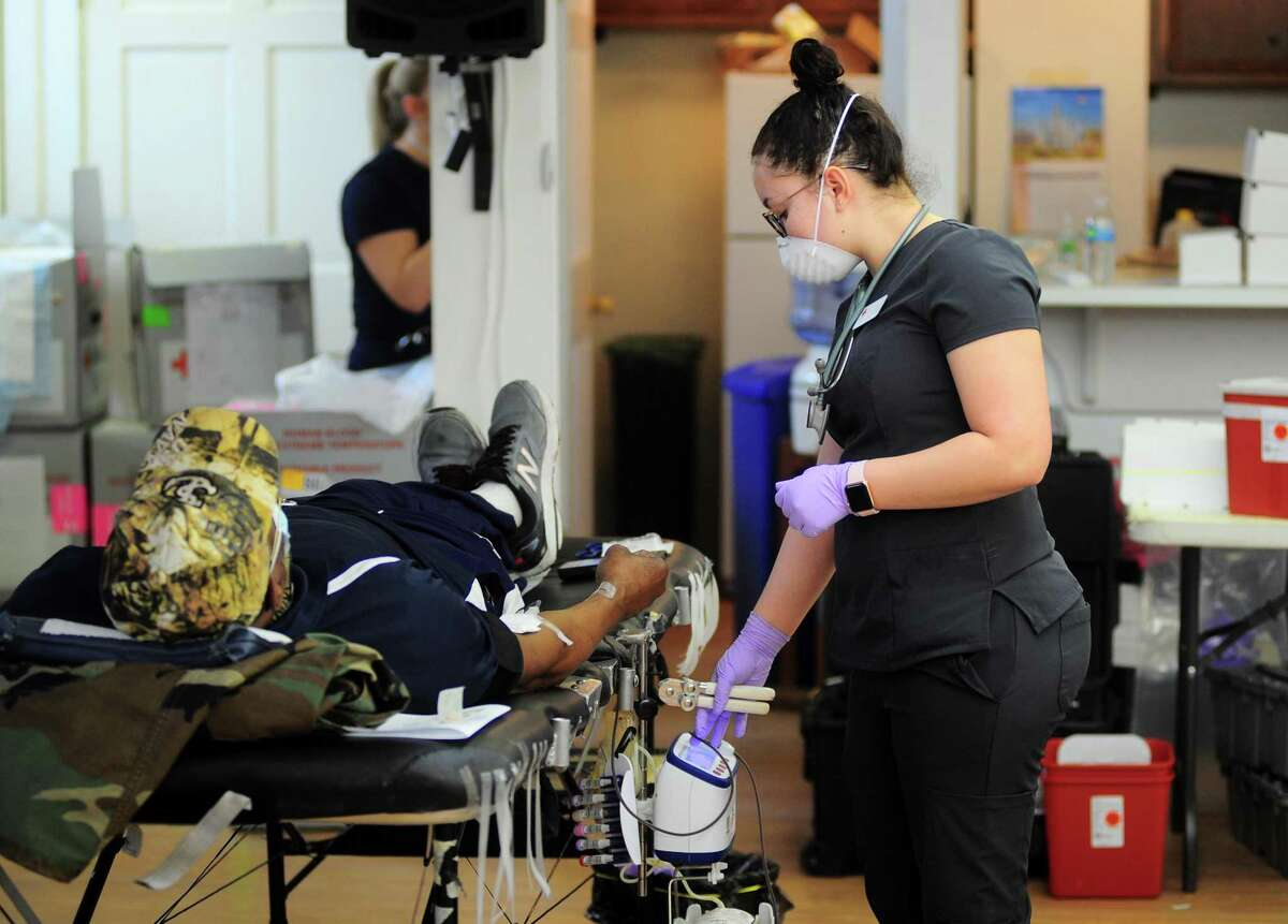 Collection Technician Jayla Ramos prepares donated blood during a American Red Cross blood drive at Whitneyville Cultural Commons in Hamden, Conn., on Friday Apr. 3, 2020.