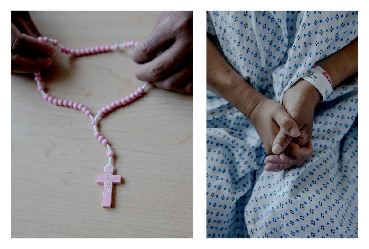 """Maria, who is Catholic, holds a rosary that she keeps in her patient room. """"My hope is that they are going to help me to get me dialysis outpatient,"""" she said."""