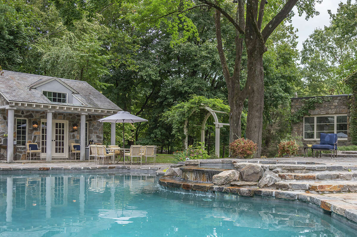 """With itsheated Gunitepool, cabana and hot tub, the FraserLane home's outdoor living space was featured on HGTV'sas a """"Top 10 Outside Living Space,"""" according to the listing."""