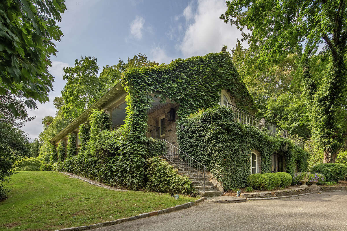 The ivy-covered home on 2 Fraser Lane in Westportwas once owned by sculptors. The home onceserved as couple'sstudio, according to the listing.