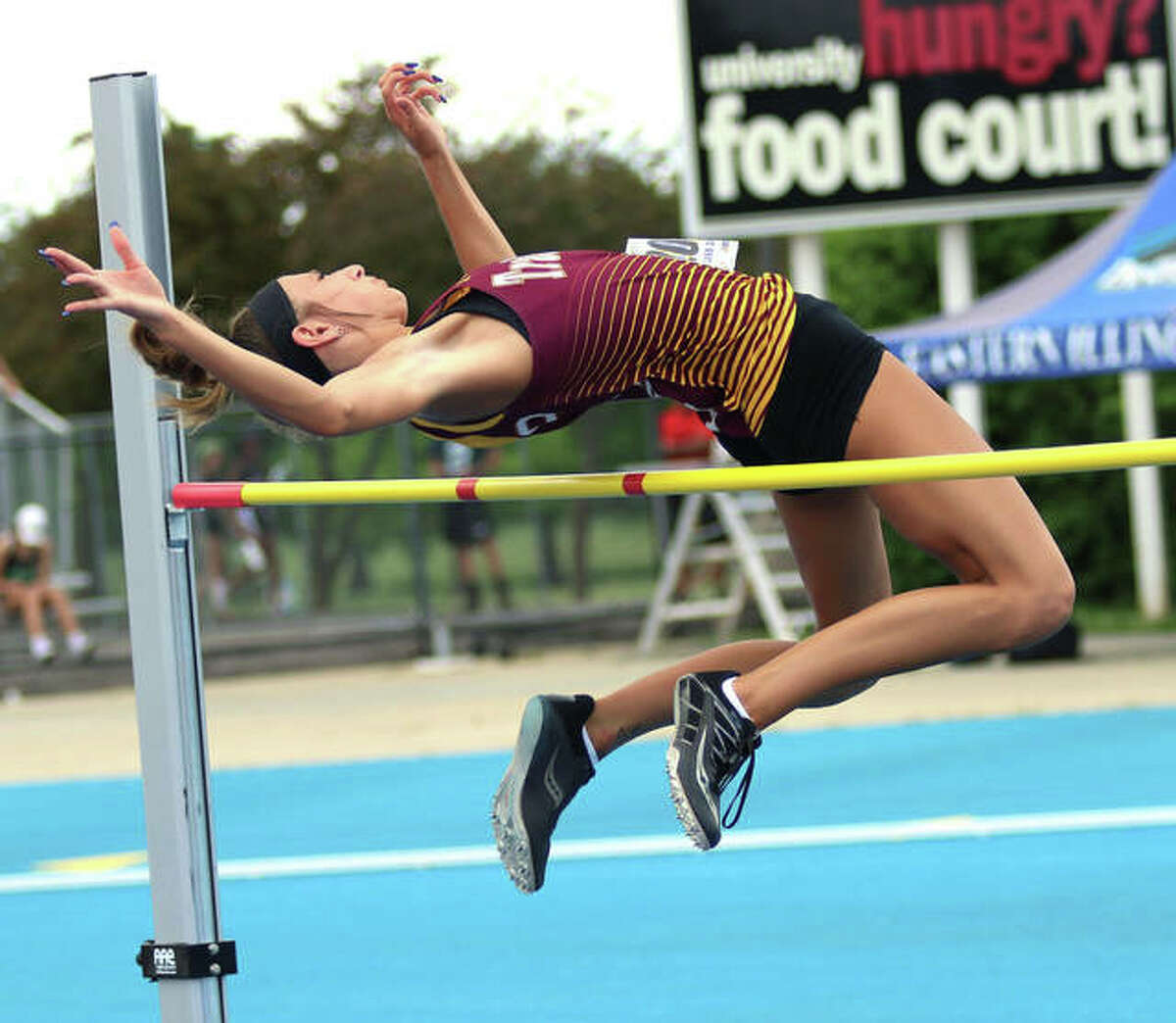EA-WR senior Hannah Sechrest gets over the bar at 5 feet, 2 inches in the high jump at the Class 2A state meet Friday at O'Brien Stadium in Charleston. Sechrest finished seventh in the event, adding the the eighth-place state medal she won as a sophomore.