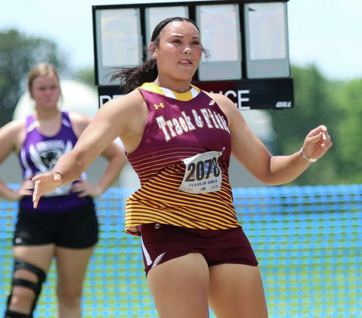 EA-WR senior Jayden Ulrich watches one of her throws in the shot put Friday in the Class 2A state meet at Charleston. Ulrich repeated as state champion in the shot and added a state title in the discus.