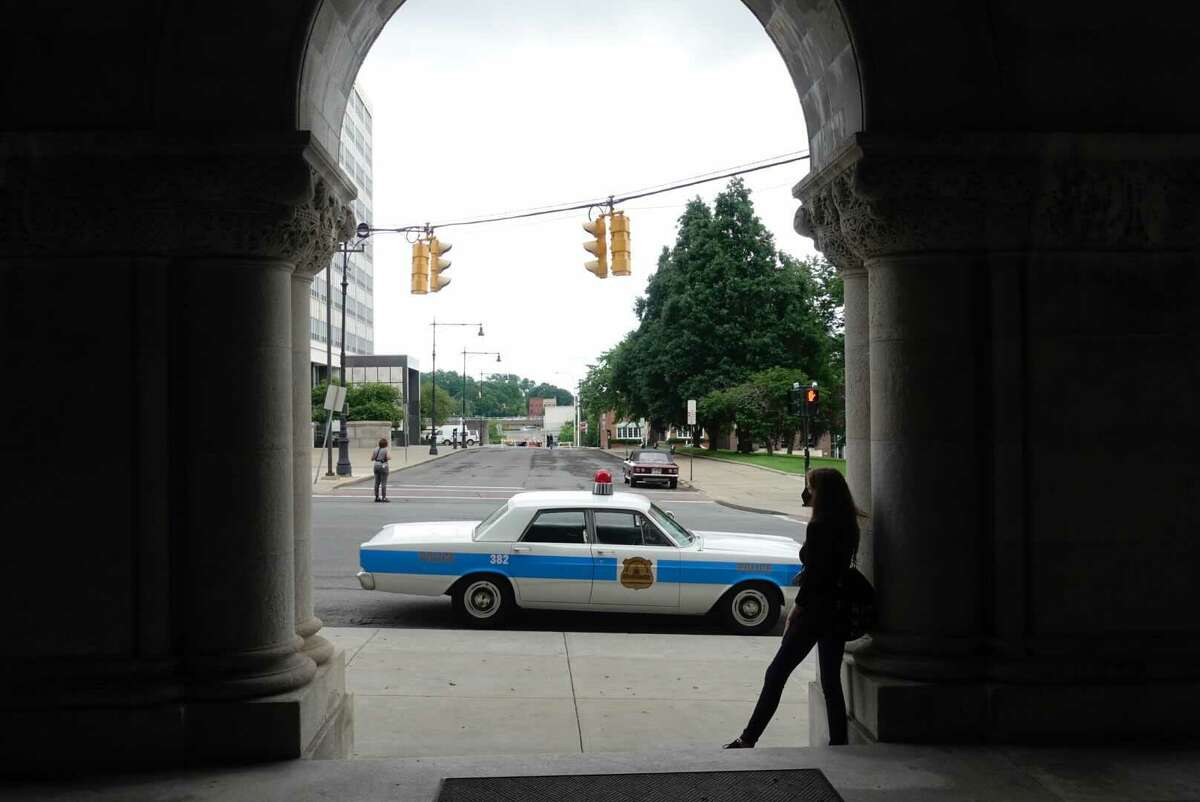 """1960s and 1970s-era classic cars lined Washington Avenue as shooting forthe Watergate HBO limited series """"The White House Plumbers,""""began at 3 a.m. on Tuesday, June 15 at Albany's Capitol."""