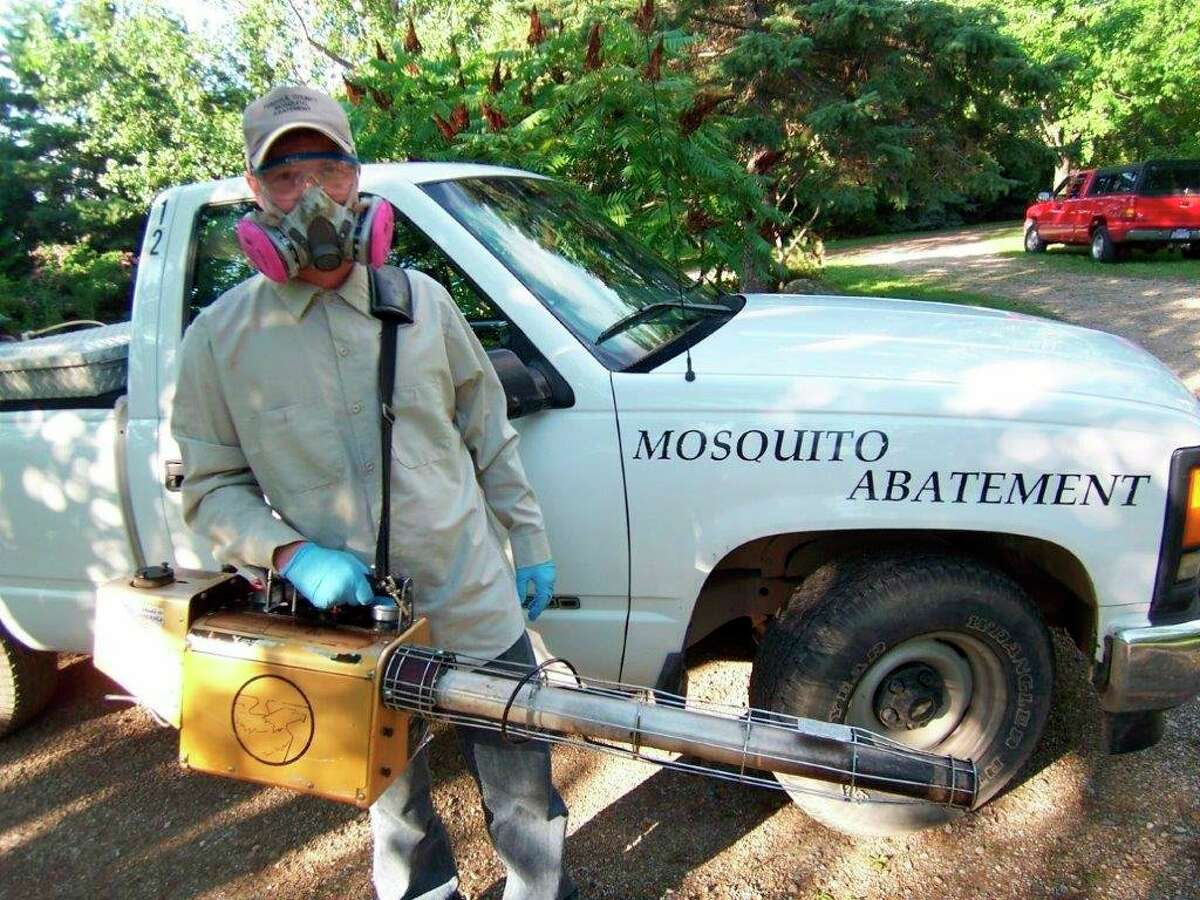 """ThisTuscola County Mosquito Abatement employee is fully equipped and ready to""""fog"""" a residential yard to eliminate mosquitoes. (Tom Lounsbury/Hearst Michigan)"""