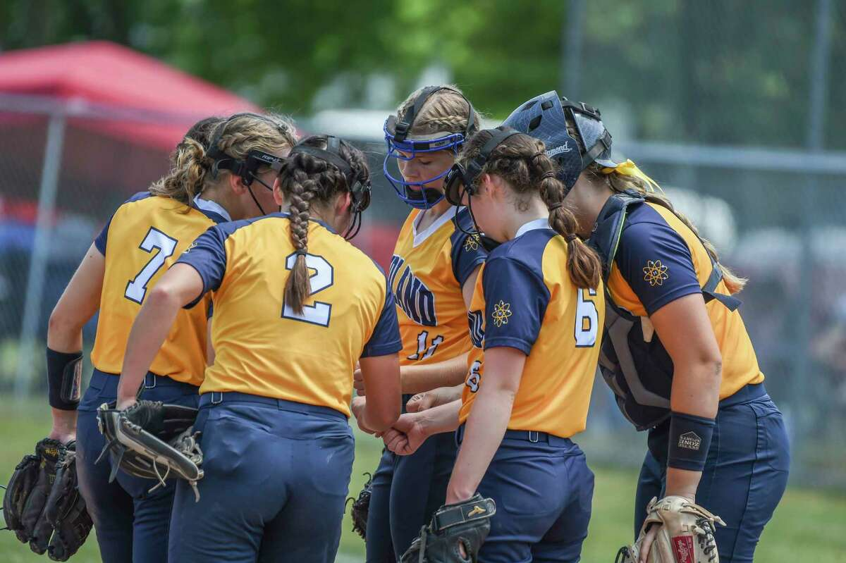 Midland High'sinfield gathers in the pitchers' circle during Saturday's Division 1 softball regional semifinal against Traverse City West at Bay City's MacGregor Elementary School.(Adam Ferman/for the Daily News)