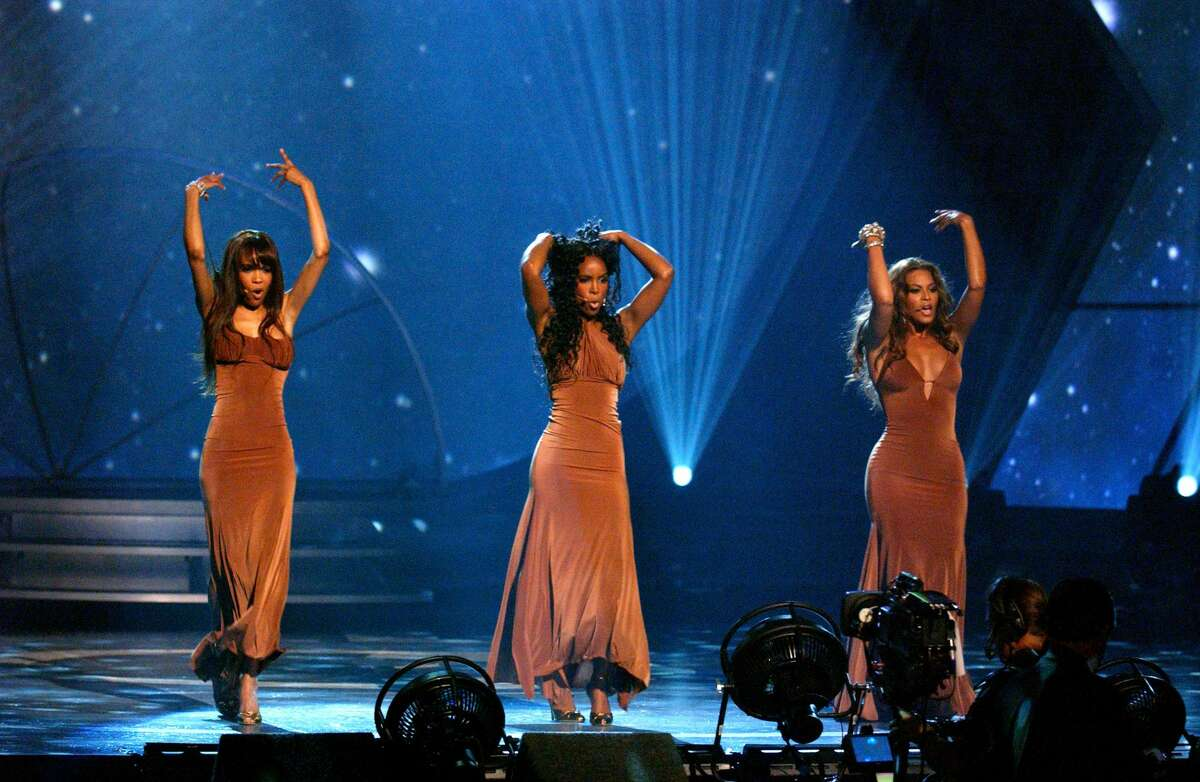 """Destiny's Child performs """"Cater 2 U"""" during the 2005 BET Awards Show at Kodak Theatre in Hollywood, California. (Photo by M. Caulfield/WireImage for BET Entertainment)"""