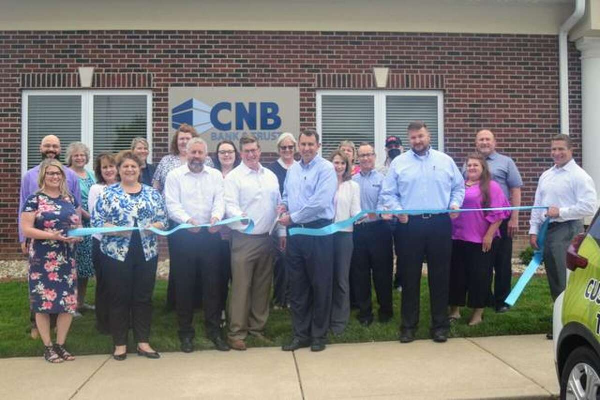 Market President Brian Ury, center, and the entire team at the ribbon cutting at New CNB Bank & Trust, 212 Evergreen Lane, Glen Carbon.