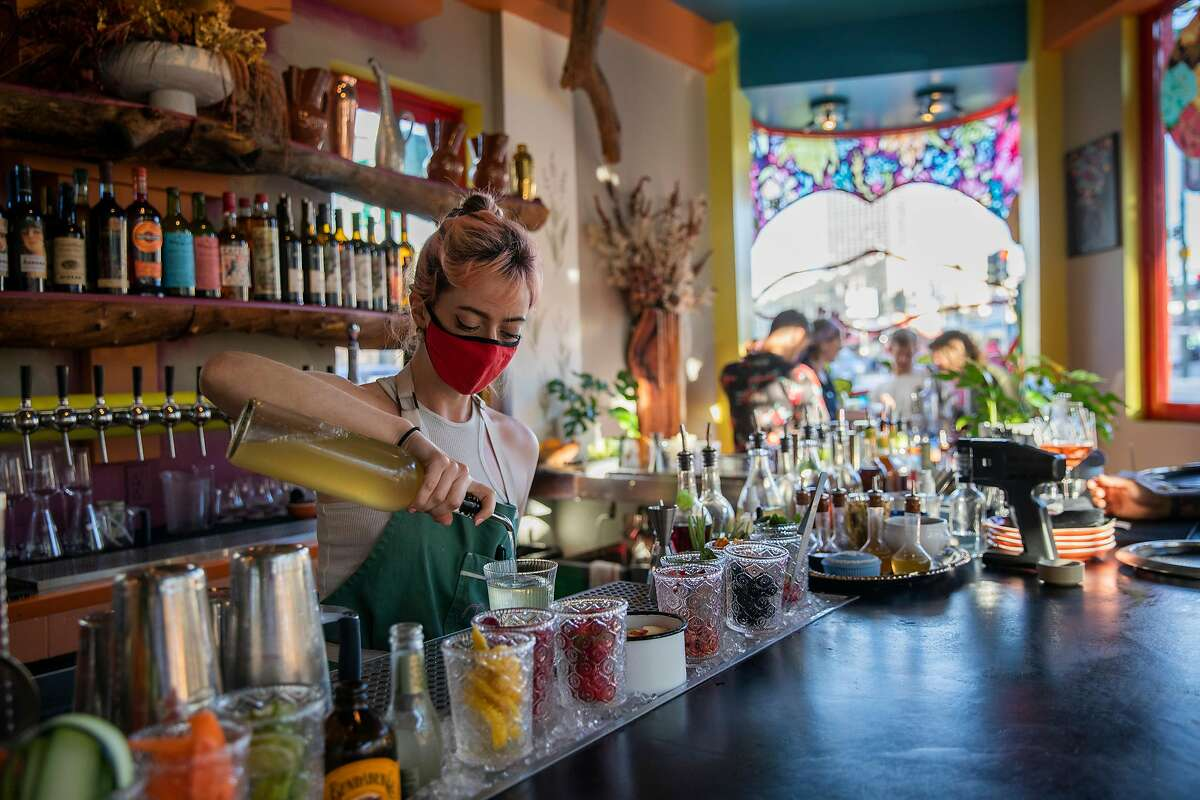 Natalie Lichtman makes drinks for customers at Red Window, Saturday, June 12, 2021, in San Francisco, Calif. The restaurant is located at 500 Columbus Ave.