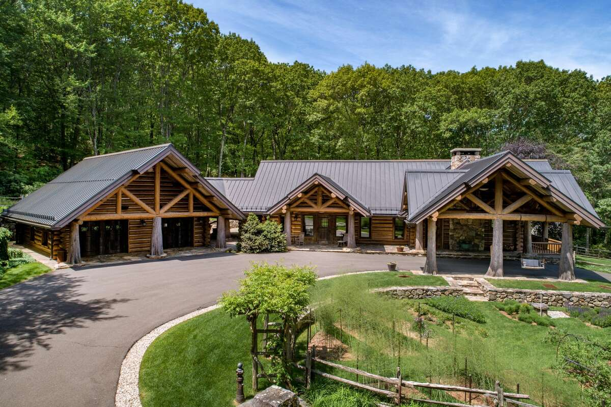 The Old WolcottRoad home has all the traditional features of a log cabin - log pillars, log walls, stone finishes and a full copper roof.