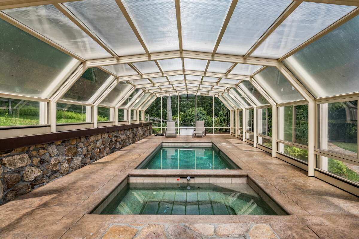 On the home's property is a lap pool and Jacuzzi covered by a retractable roof, which allows for use all four seasons.