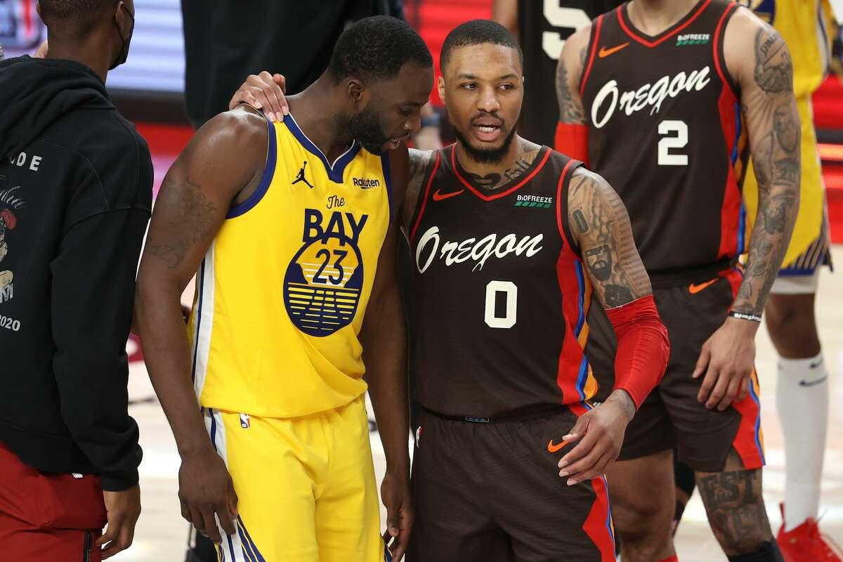 Draymond Green of the Golden State Warriors and Damian Lillardof the Portland Trail Blazers have a conversation after the Portland Trail Blazers defeated the Golden State Warriors 108-106 at Moda Center on March 3, 2021.