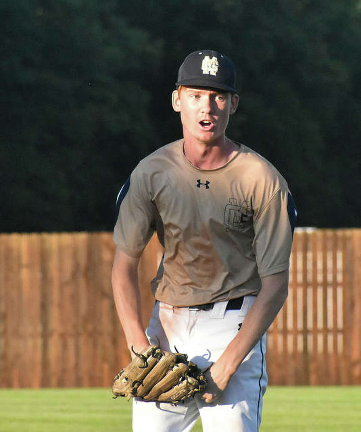 Father McGivney starting pitcher Drew Sowerwine is fired up after getting out of a jam in the third inning against Camp Point Central on Monday in Springfield.
