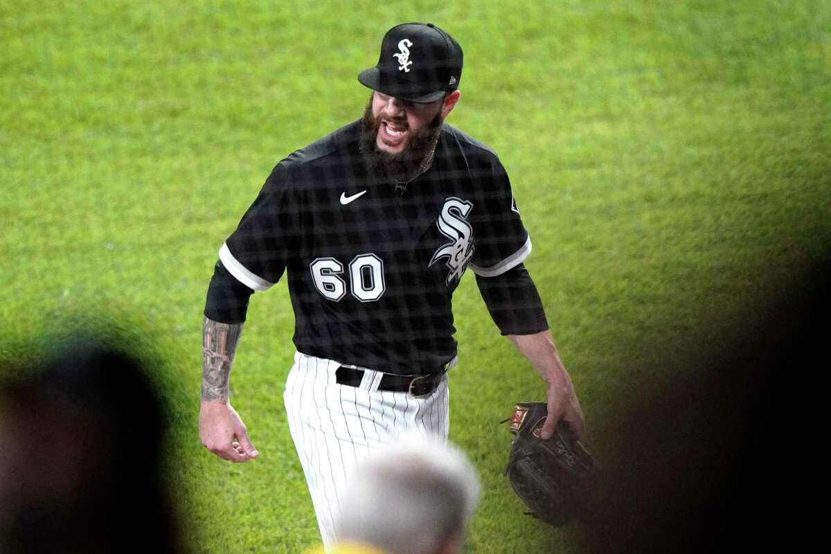 Chicago White Sox starting pitcher Dallas Keuchel reacts as he walks to the dugout during the sixth inning against the Toronto Blue Jays in Chicago, Thursday, June 10, 2021. (AP Photo/Nam Y. Huh)
