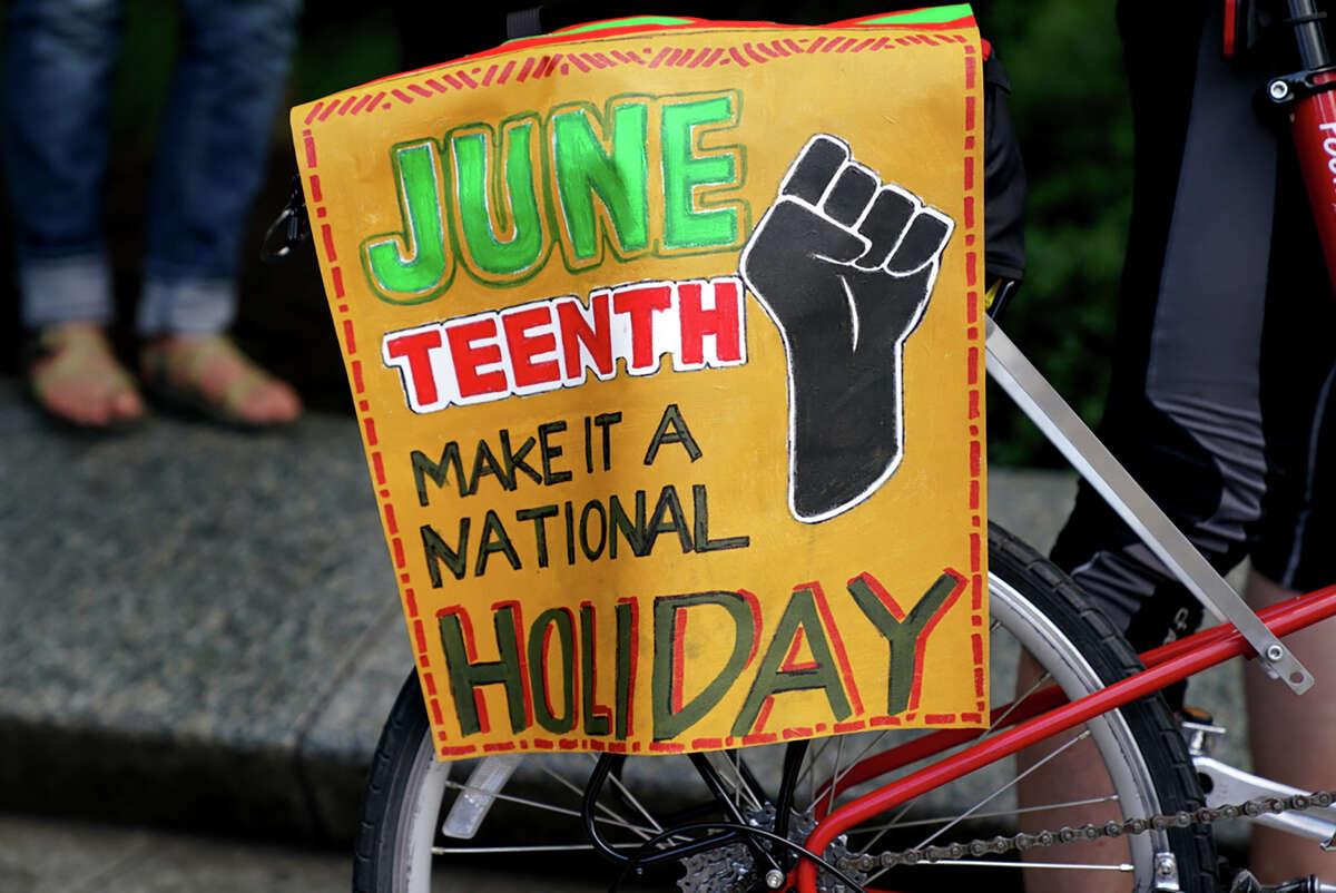 A Juneteenth event in Washington, D.C., in 2020 features a sign encouraging the day become a federal holiday.