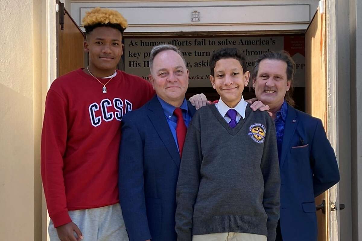 The Fisher-Paulson family consists of Zane (left), Kevin, Aidan and Brian Fisher-Paulson.