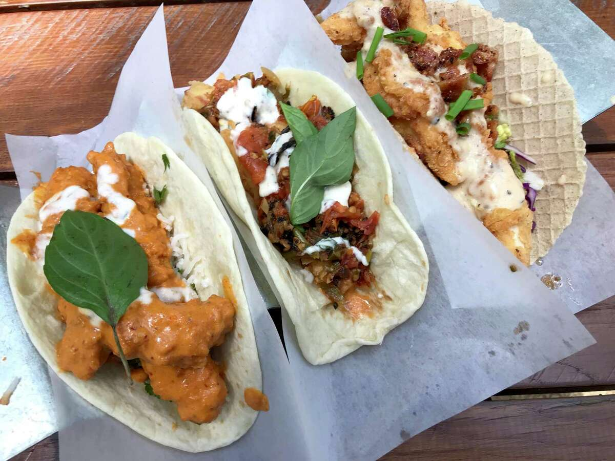 A trio of tacos includes, from left, Spicy Tikka Chicken, Fried Paneer and Chicken & Waffle from Velvet Taco.