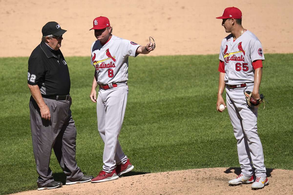 St. Louis Cardinals manager Mike Shildt, center, continues to speak his mind as he points to relief pitcher Giovanny Gallegos after third base umpire Joe West, left, ejected Shildt during the seventh inning of an interleague baseball game against the Chicago White Sox Wednesday, May 26, 2021, in Chicago. (AP Photo/Charles Rex Arbogast)