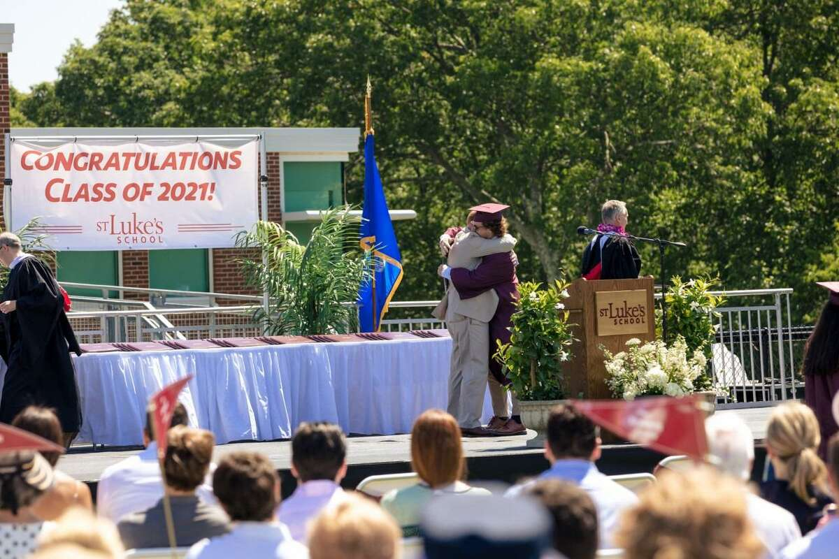 Wilton resident James Andersen, and St. Luke's School Board of Trustees Chair, hugs his son Austin during the school's recent 92nd Commencement Ceremony.