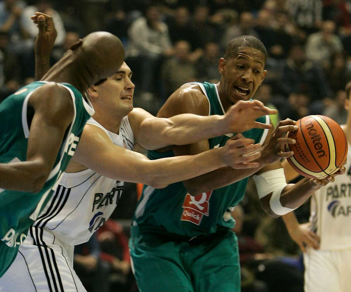 Dejan Milojevic (center) fights for the ball during his Euroleague playing days in 2005. Milojevic is now a coach.