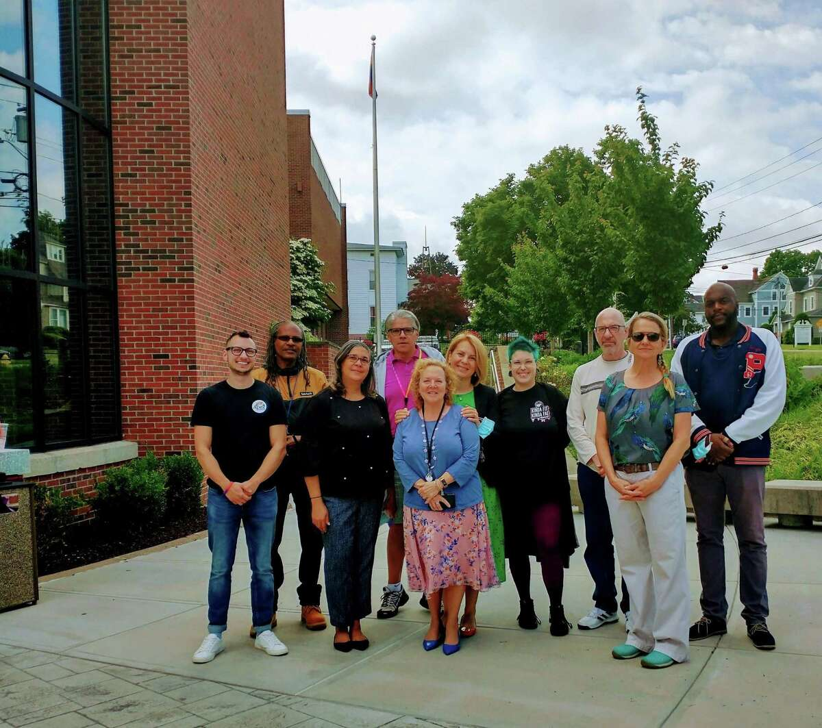 Andrea Gartner, Democratic Comittee Chairman, alongside others who provide services and support to the LGBTQ community in the region. The group gathered to observe the Pride flag raising at City Hall on June 15.