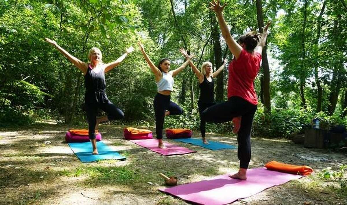 """The Woodcock Nature Center in Wilton is offering """"Yoga in the Woods,"""" on Saturday, June 19, Saturday, July 10, and Saturday, August 28, all from 8:30 to 9:45 a.m."""
