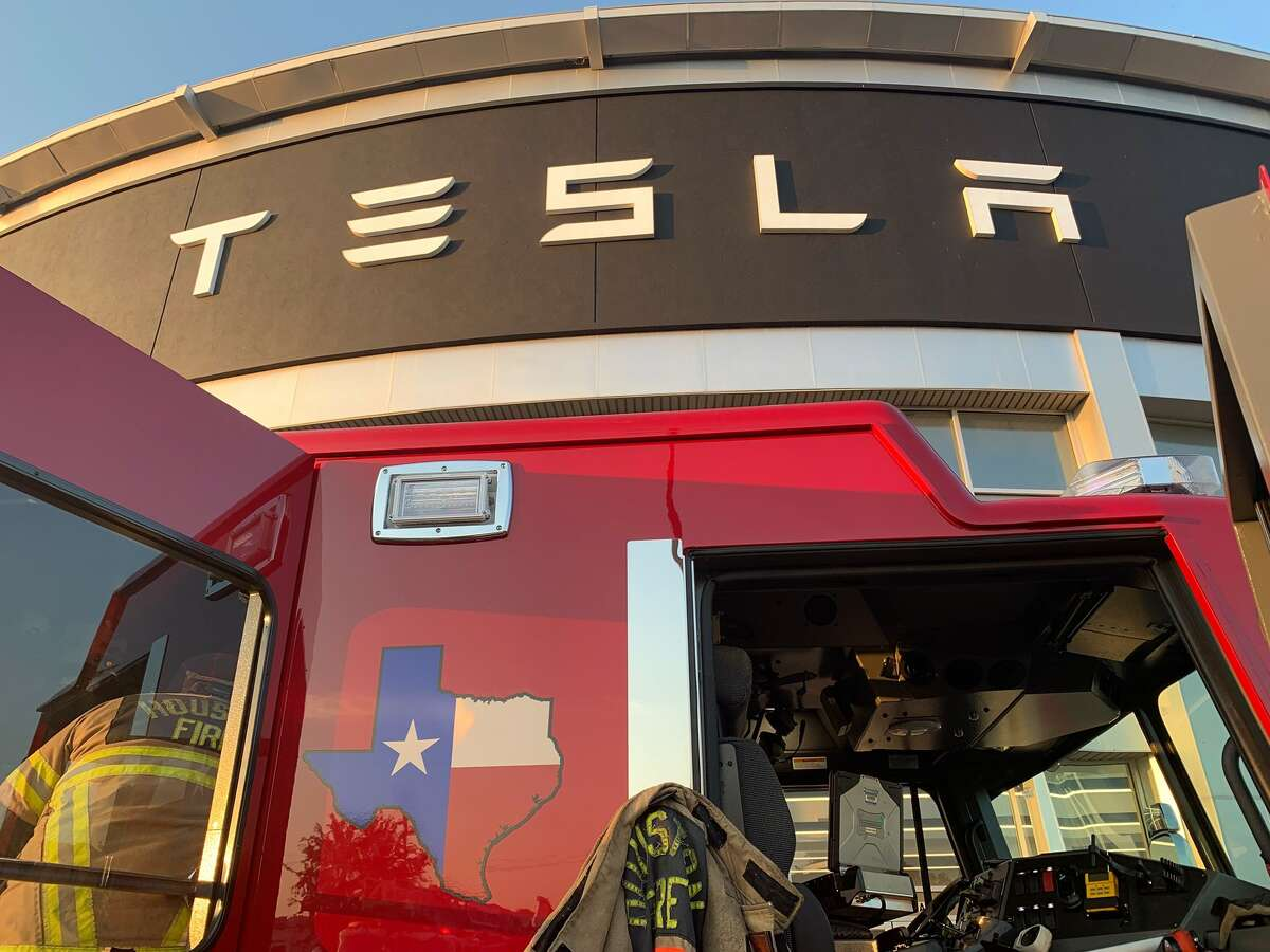 Firefighters arrived at the Tesla dealership after reports of a fire within five minutes.