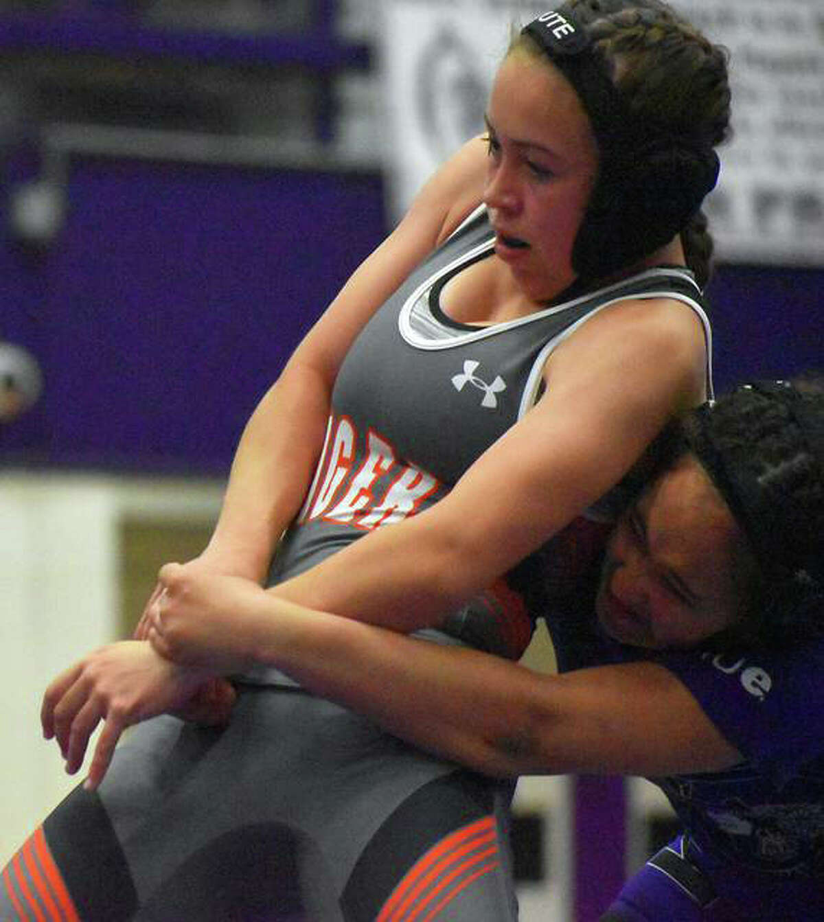 Edwardsville's Olivia Coll tries to break out of a hold early in the second round of her match at 113 pounds against Collinsville on April 29.