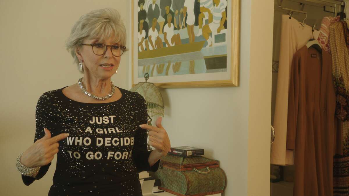 """Even at 89 years old, the iconic, EGOT-winning subject of """"Rita Moreno: Just a Girl Who Decided to Go for It"""" knows the key to living in America: self-promotion."""