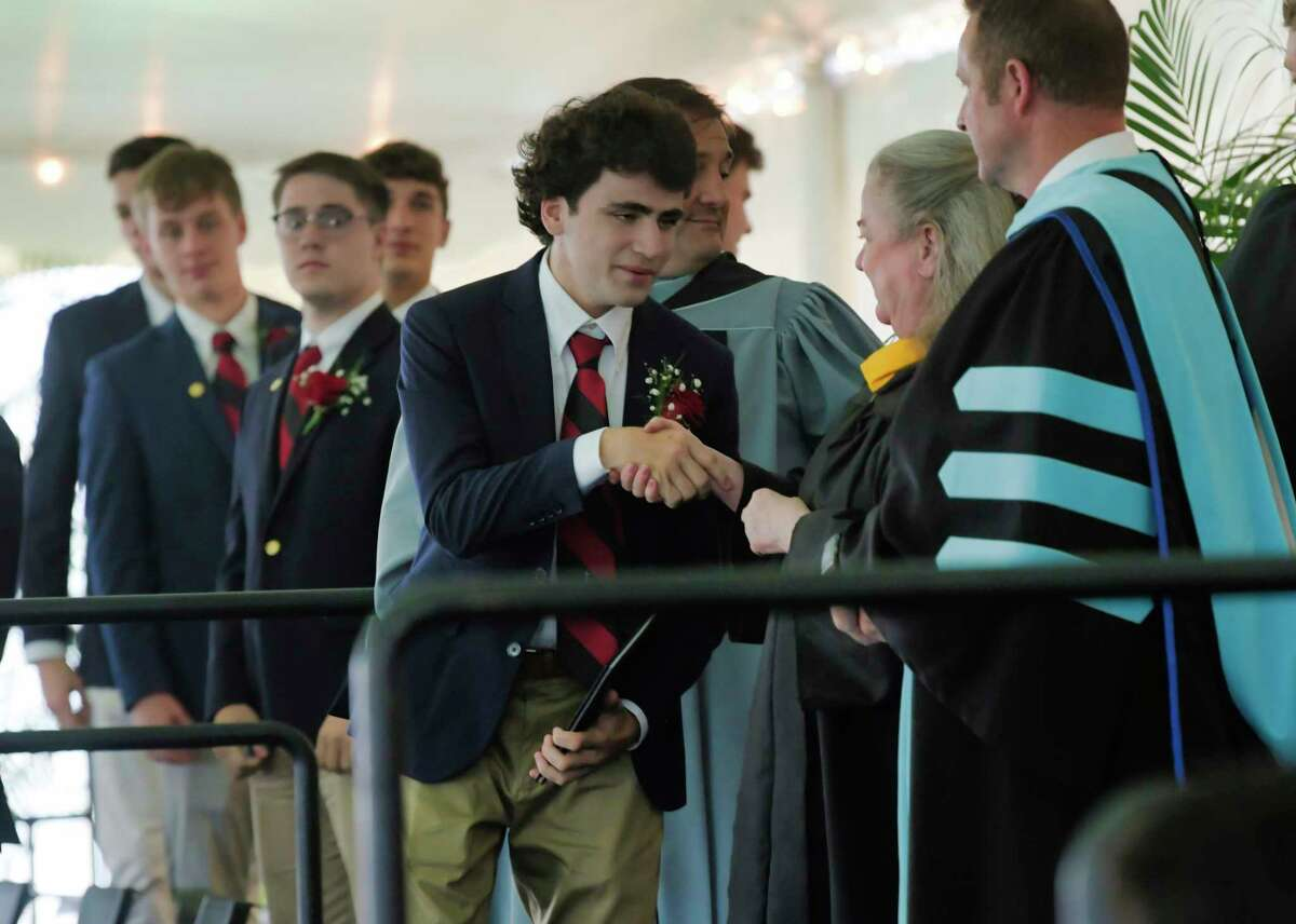 Albany Academy graduate, Seamus Fleischer, shakes hands with Nancy Carey Cassidy, president of the Board of Trustees, as he received his diploma during the school's graduation ceremony on Tuesday, June 15, 2021, in Albany, N.Y. (Paul Buckowski/Times Union)