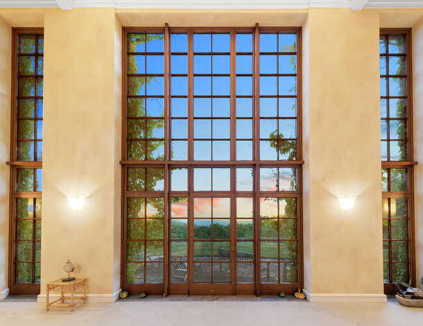 The Cornwall estatehas floor-to-ceiling windows that overlook its 550 acres of property. Photo: Dot Record Media / DefiningStudios