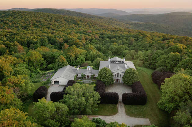 Located in the northwest corner of Connecticut, the home on 141 5 1/2 Mile Road in Cornwall has views of Massachusetts, Connecticut and New York, according to the listing. Photo: Dot Record Media