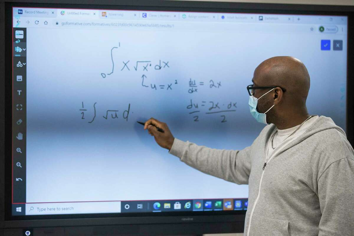 North Houston Early College High School math teacher Andre Shackelford, pictured in February, leads a class at his Houston ISD campus. High school students across Texas scored significantly lower this year on state standardized math tests, with Black, Hispanic and lower-income students falling the farthest behind.
