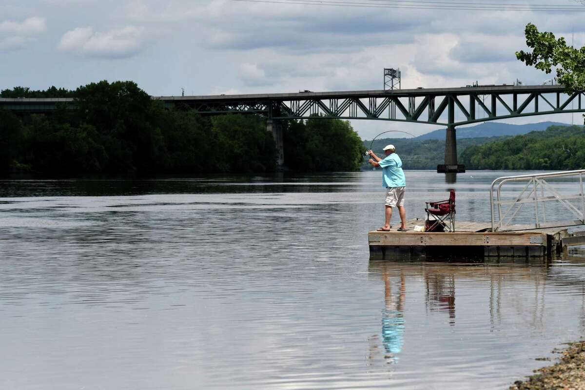 Rick Harbeck of Rensselaer casts his line into the Hudson River while fishing at Hilton Park on Tuesday, June 15, 2021, in Rensselaer, N.Y. (Will Waldron/Times Union)