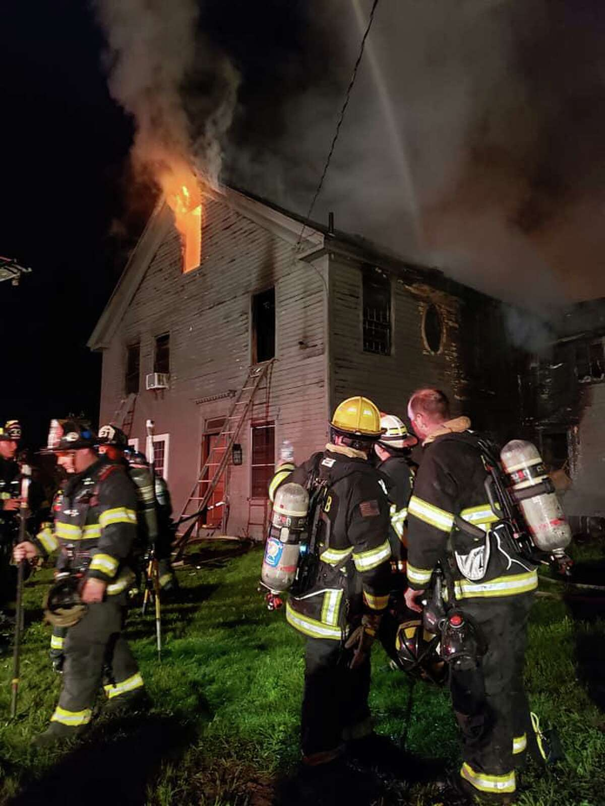 A fire at a farmhouse in Woodstock, Conn., during the early morning hours of Tuesday, June 15, 2021.