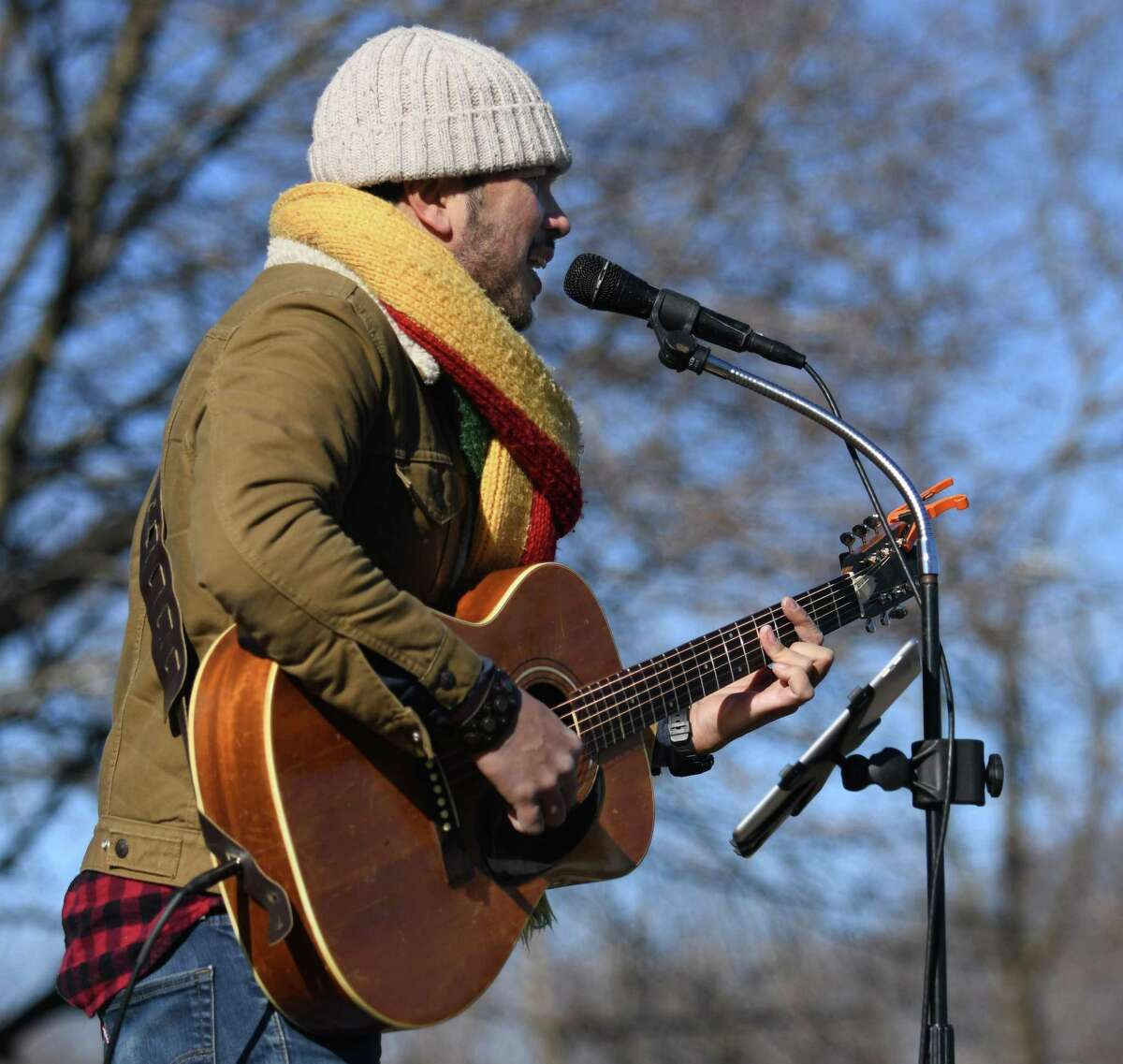 Rick Reyes performs at the debut of the Shakespeare Market on the grounds of the former American Festival Shakespeare Theater in Stratford, Conn. Sunday, Jan. 17, 2021. The twice-monthly outdoor market made its debut Sunday on the site of the former Shakespeare Theater, which was destroyed in a fire two years ago. The market featured 20 vendors - a mix of arts, clothing, food, and more - with another 70 that have asked to be included in the future.