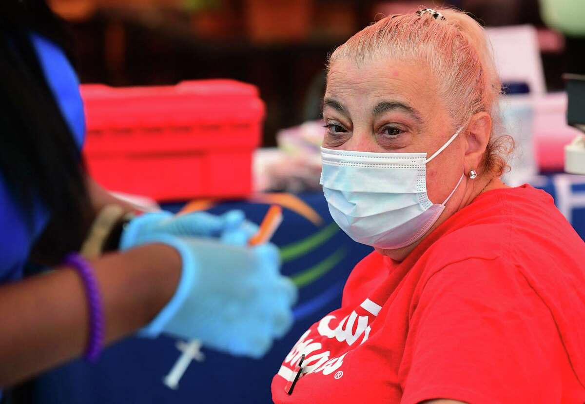 Stew's employee Adrianna Hormel receives the shot during the Griffin Hospital COVID-19 vaccination clinic at Stew Leonard's flagship store Tuesday, June 15, 2021, in Norwalk, Conn. The free clinic continues Wednesday, June 16, 2021, at the Norwalk store.