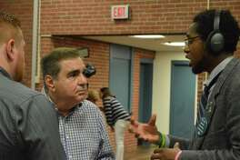 Hamden Police Commission Chairman Micheal Iezzi, center, speaks with Councilman Justin Farmer, D-5, right, and Councilman Brad Macdowall, D-9, before a commission meeting May 8, 2019.