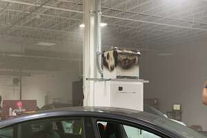 A supercabinet fire appears to have been the source of smoke and flames at a Houston Tesla dealership.