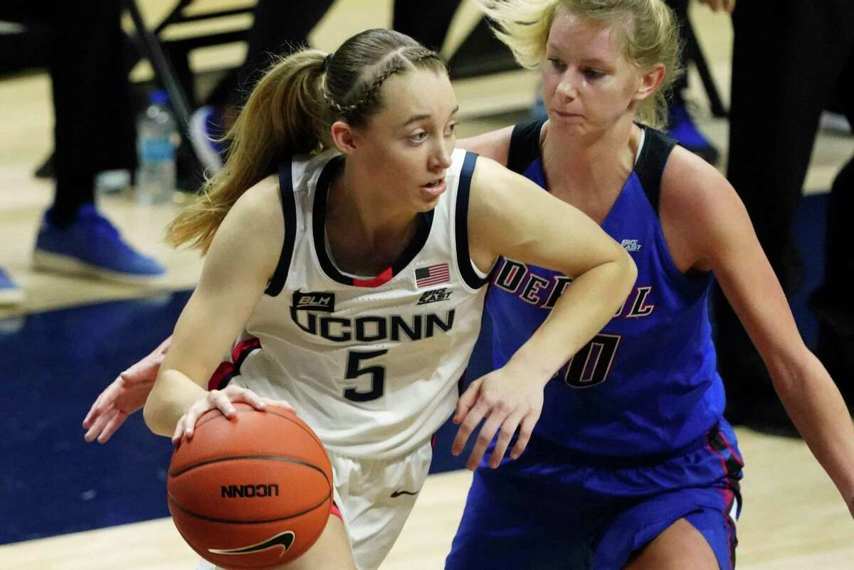 Connecticut guard Paige Bueckers (5) drives against DePaul guard Lexi Held (10) in the first half of an NCAA college basketball game Tuesday, Dec. 29, 2020, in Storrs, Conn.
