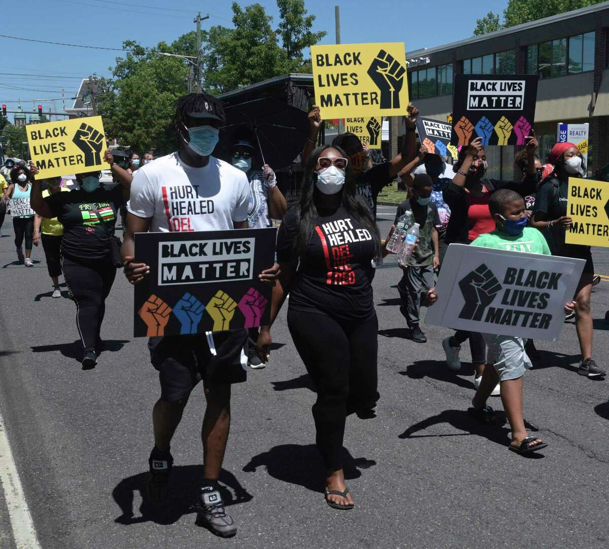 A prayer walk in protest of racial injustice to mark one month since the slaying of George Floyd in Minneapolis, went from the Police HQ to City Hall mid-day, Thursday, June 25, 2020, in Danbury, Conn. It was led by the Rev. Leroy Parker, pastor of New Hope Baptist Church.