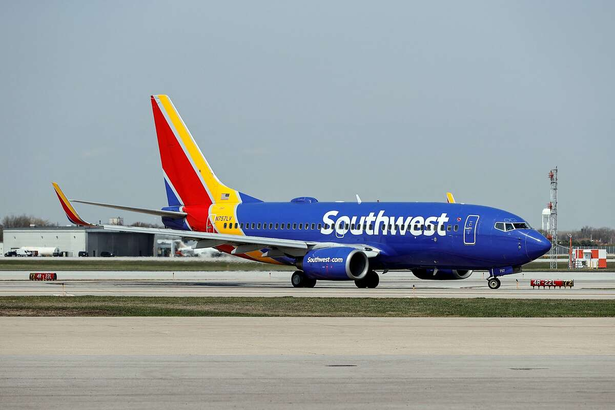 In this file photo taken on April 6, 2021 a Southwest Airlines Boeing 737-7H4 jet taxis to the gate after landing at Midway International Airport in Chicago, Illinois. The airline was working to get flights back on track Tuesday afternoon after a technical issue temporarily grounded all flights across the country for the second time in 24 hours.