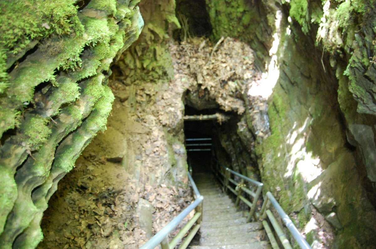 A long stairway leads you into the mouth of Illinois Caverns.